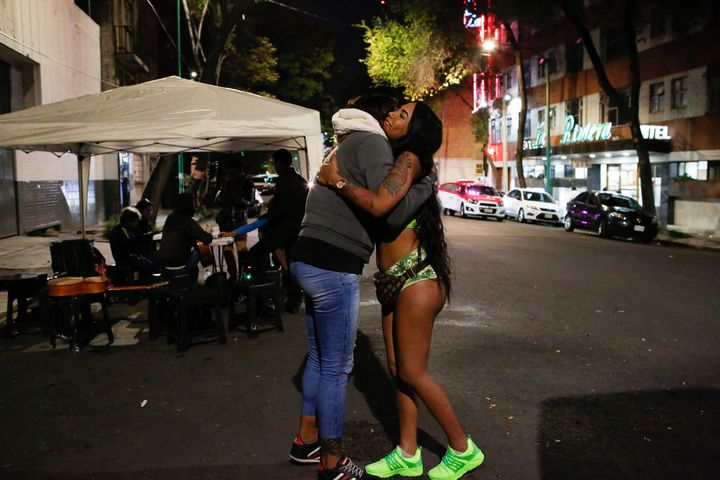Trans rights activist Kenya Cuevas embraces Angie, a 20-year-old transgender sex worker, in Mexico City.