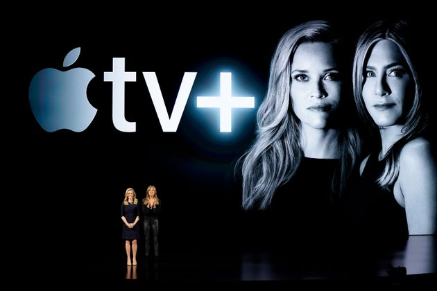 "Reese Witherspoon, left, and Jennifer Aniston speak about their Apple TV Plus drama ""The Morning..."