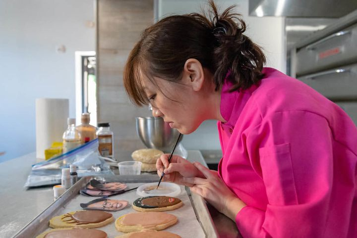 Jasmine Cho works on a cookie.