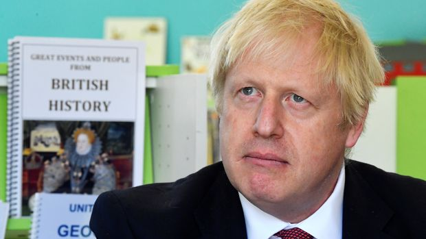 Prime Minister Boris Johnson speaks with year four and year six pupils during a visit to Pimlico Primary school in South West London, to meet staff and students and launch an education drive which could see up to 30 new free schools established.