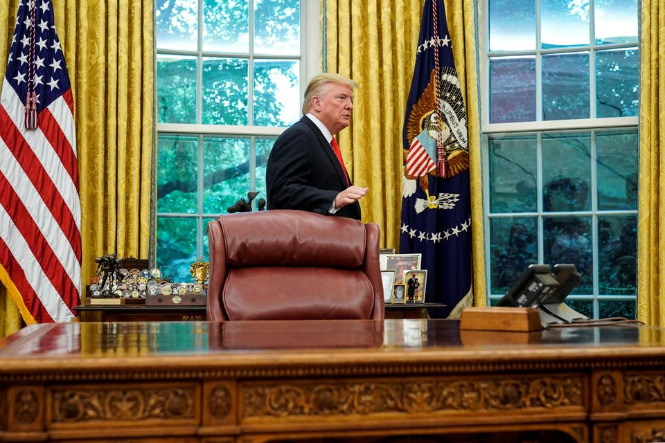 U.S. President Donald Trump departs the Oval Office following a presentation of the Presidential Medal...