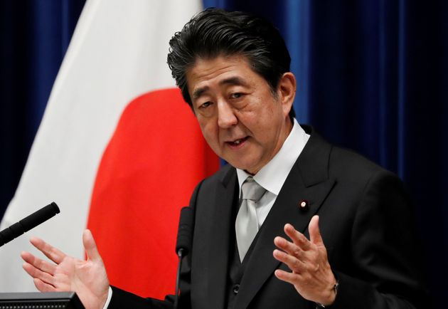 Japan's Prime Minister Shinzo Abe gestures as he speaks at a news conference after reshuffling his cabinet...