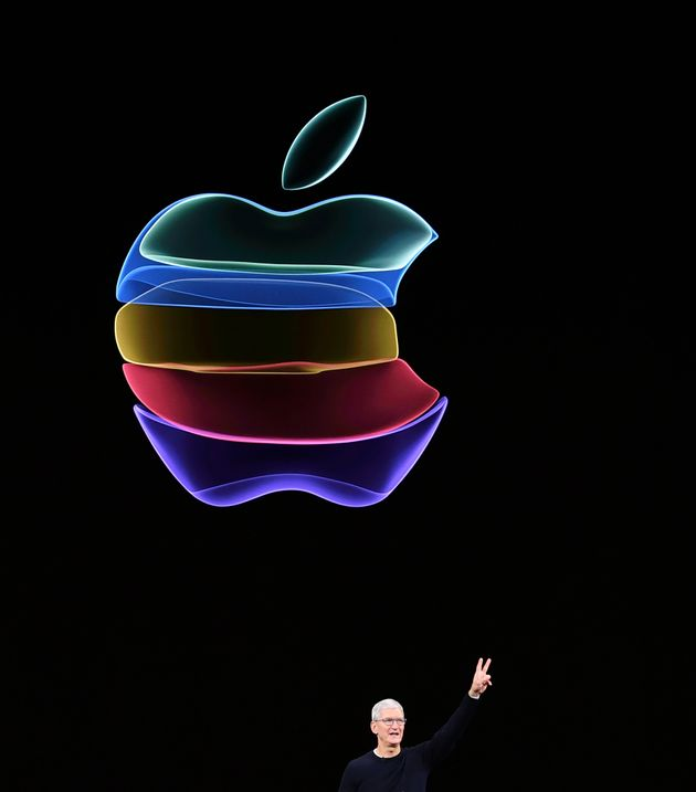 Apple CEO Tim Cook speaks on-stage during a product launch event at Apple's headquarters in Cupertino,...