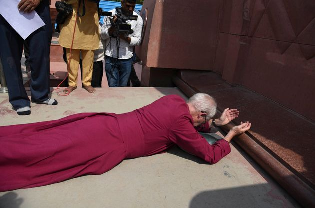 The Archbishop of Canterbury Rev. Justin Welby, prostrates as he pays respect at the Jallianwala Bagh...