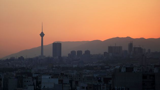 Milad telecommunications tower, left, and buildings are seen at sunset in Tehran, Iran, Monday, Aug....
