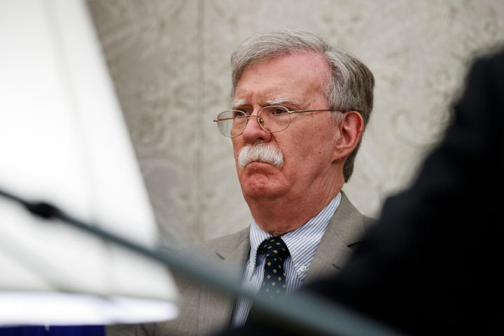 John Bolton listens as President Donald Trump speaks during a meeting with Romanian President Klaus Iohannis in the Oval Offi