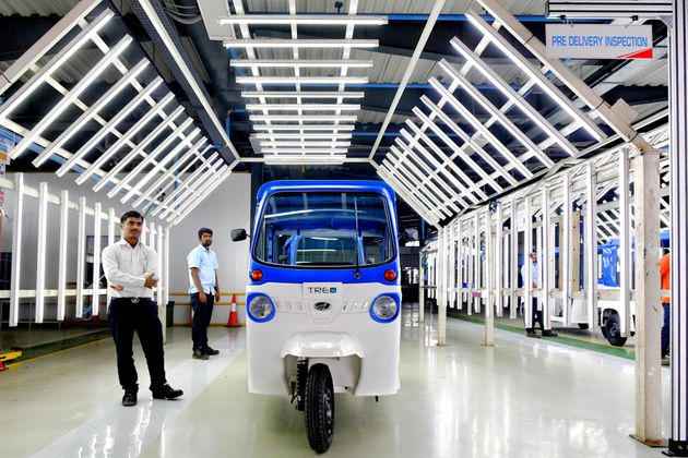 A Treo auto-rickshaw, Mahindra Electric's first lithium ion battery-powered three-wheeler, stands following...