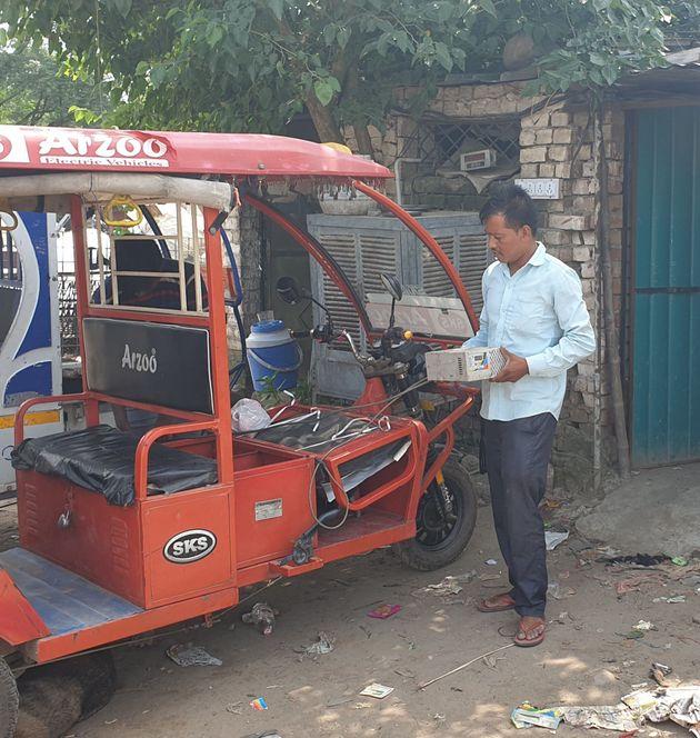 Baijnath is charging his e-rickshaw batteries at an unauthorised charging station at NAC Mani Majra...