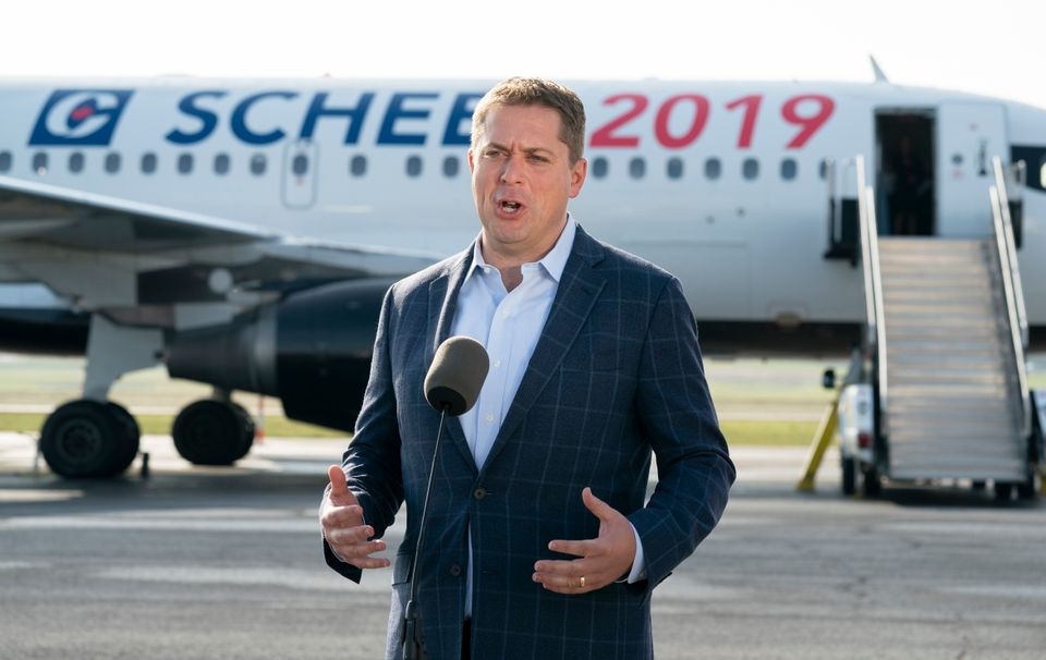 Conservative Leader Andrew Scheer talks with reporters prior to boarding his campaign plane in Ottawa...
