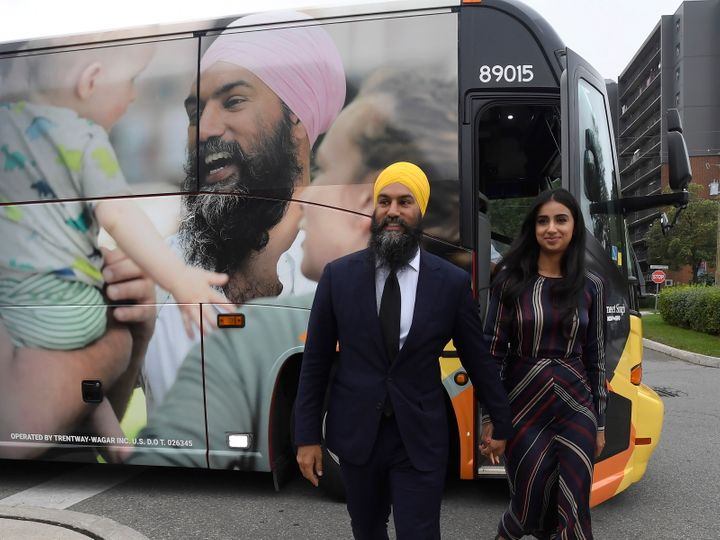 NDP LeaderJagmeetSinghand his wife Gurkiran Kaur Sidhu stand by his campaign bus in London, Ont., on Sept.11, 2019.