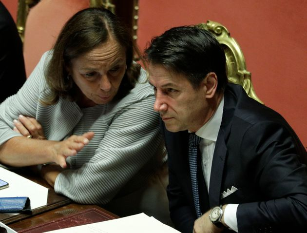 Italian Premier Giuseppe Conte listens to Interior Minister Luciana Lamorgese at the Senate ahead of...