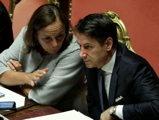 Italian Premier Giuseppe Conte listens to Interior Minister Luciana Lamorgese at the Senate ahead of...