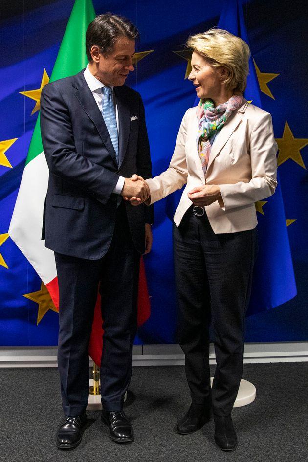 European Commission President Ursula von der Leyen (R) welcomes Italian Prime Minister Giuseppe Conte...