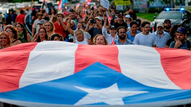 People march in protest in San Juan on July 29, 2019, against the next in line for Puerto Rico's governor, Wanda Vazquez, Puerto Rico's current Secretary of Justice. - A political crisis over leadership in the US Caribbean territory of Puerto Rico took another turn when the designated successor to embattled governor Ricardo Rossello said she didn't want the job. Secretary Vazquez, Rossello's number two, was set under the constitution to take over on August 2 as interim governor for the island which is gripped by a decade-long recession. (Photo by Ricardo ARDUENGO / AFP)        (Photo credit should read RICARDO ARDUENGO/AFP/Getty Images)