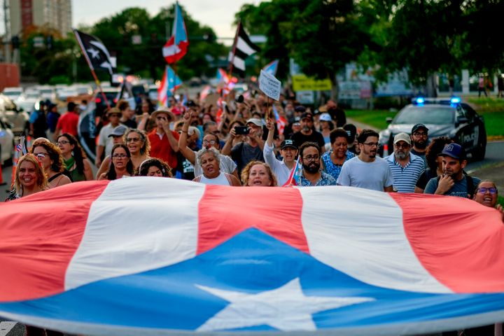 People march in protest in San Juan on July 29, 2019, against the next-in-line for Puerto Rico's governorship, Wanda V&aacute