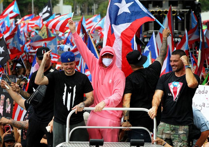 Artists Residente and Bad Bunny join a march a day after Puerto Rico's then-governor, Ricardo Rosselló, announced he w