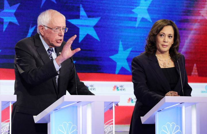 Democratic presidential candidates Sen. Bernie Sanders and Sen. Kamala Harris take part in the second night of the first Demo