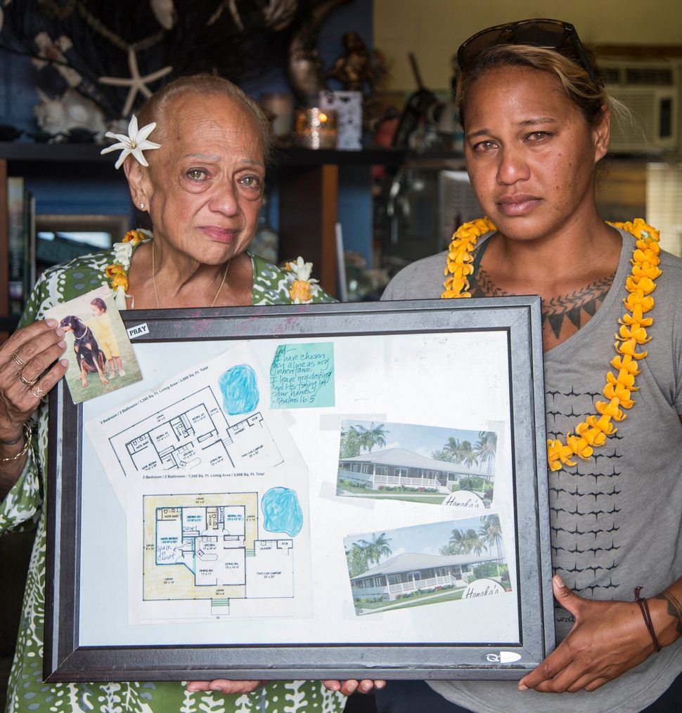 Joddy ʻIwalani Manuwai and her daughter Kaʻiulani Manuwai hold the blueprints for what their home was supposed to look like a