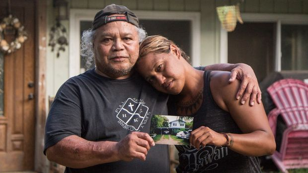 Steven Oiph (left) poses for a portrait with his youngest daughter, KaÊ»iulani Manuwai (right) in the yard of their Kailua, HI home on Sept. 4, 2019.