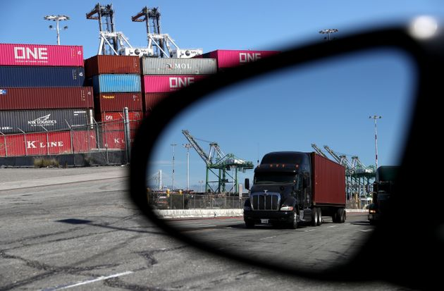 OAKLAND, CALIFORNIA - SEPTEMBER 03: A truck loaded with a shipping container drives through the Port...
