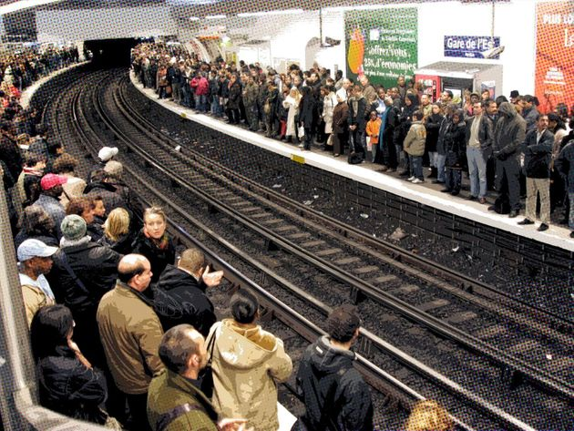 Commuters wait for the metro at the Gare de l'Est station during strike by rail workers, Paris, France,...