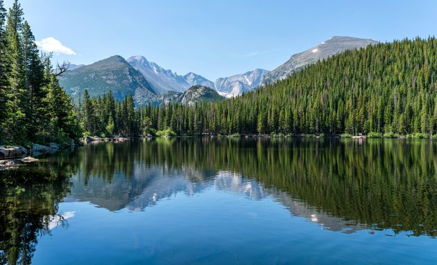Longs Peak and Glacier Gorge reflecting in blue Bear Lake on a calm Summer morning, Rocky Mountain National...