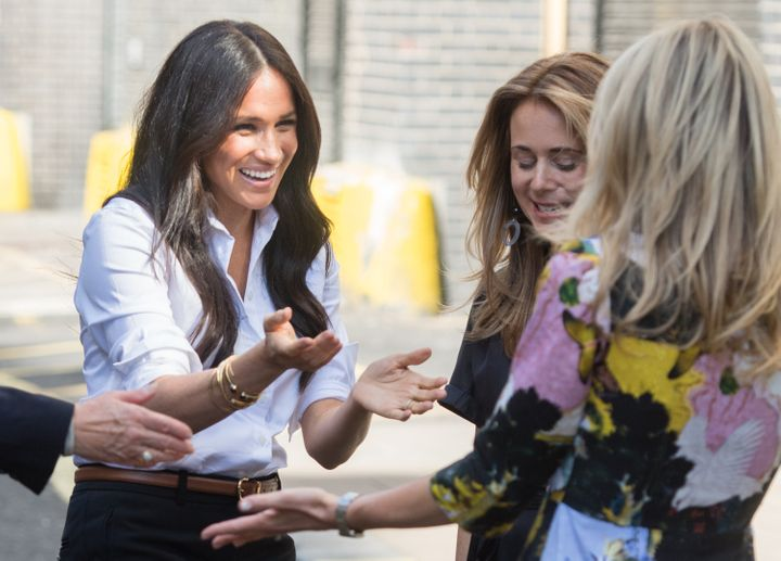 Meghan chatting at the launch of her event.