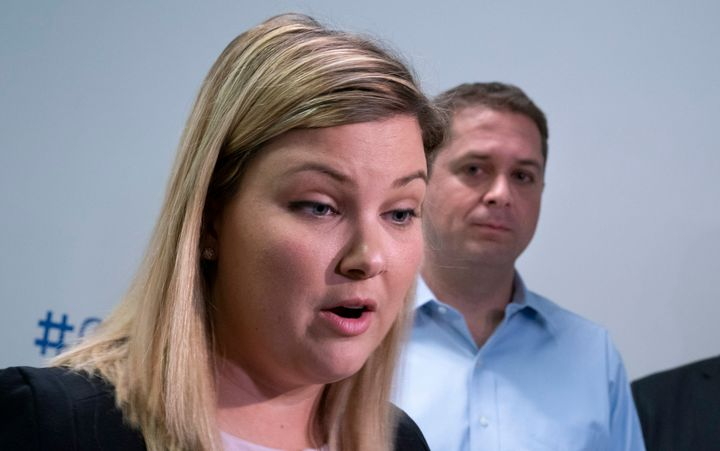 Conservative candidate for York Centre Rachel Willson responds to questions from reporters as leader Andrew Scheer looks on while visiting a daycare in Toronto on Sept. 12, 2019.
