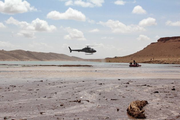 A helicopter flies over the Damchan river near the city of Errachidia, in the El Khank region in southern...