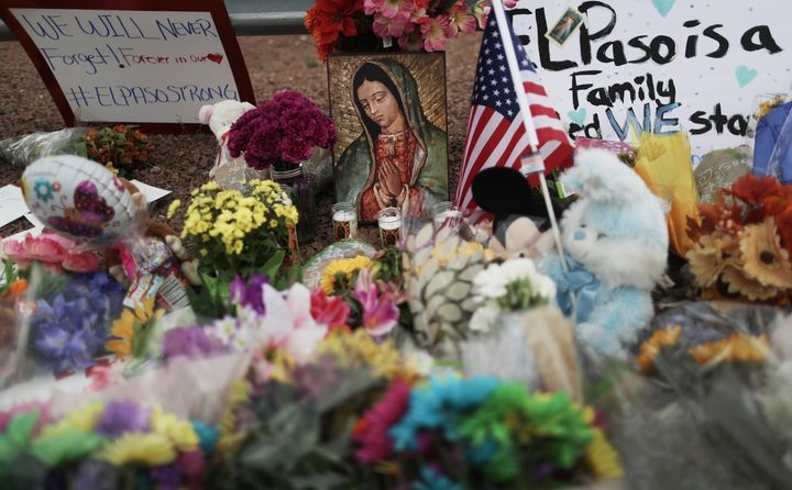 EL PASO, TEXAS - AUGUST 04:  Flowers and mementos are seen at a makeshift memorial outside Walmart, near the scene of a mass