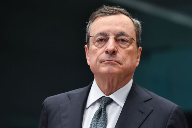European Central Bank President Mario Draghi looks on during an Eurogroup meeting at the European Commission,...