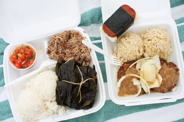 This lunch plate includes Kalua pork and pork lau lau with lomi lomi salmon, loco moco with brown rice...