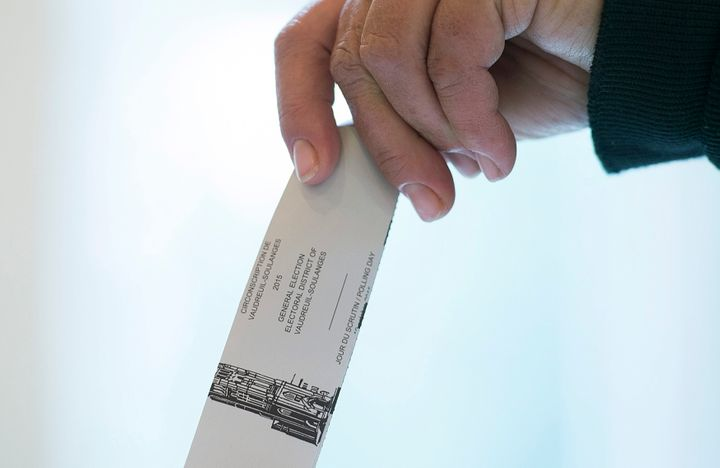 File photo of a voter casting a ballot in the riding of Vaudreuil-Soulanges, west of Montreal, on election day on Oct. 19, 2015.