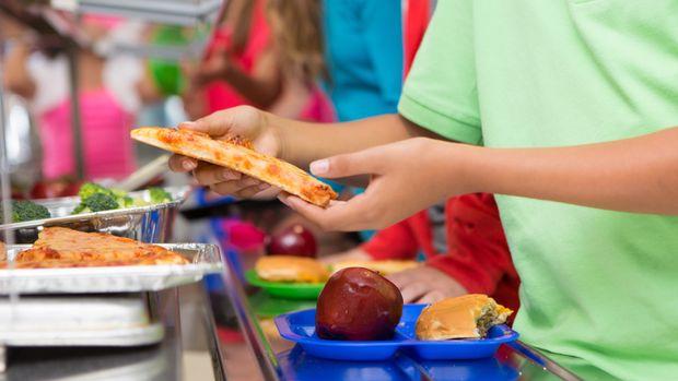 Elementary students choosing healthy/unhealthy food in school cafeteria line