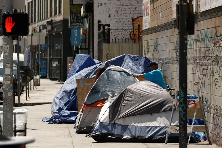 Tents and tarps erected by homeless people are shown along sidewalks and streets in the skid row area of downtown Los Angeles