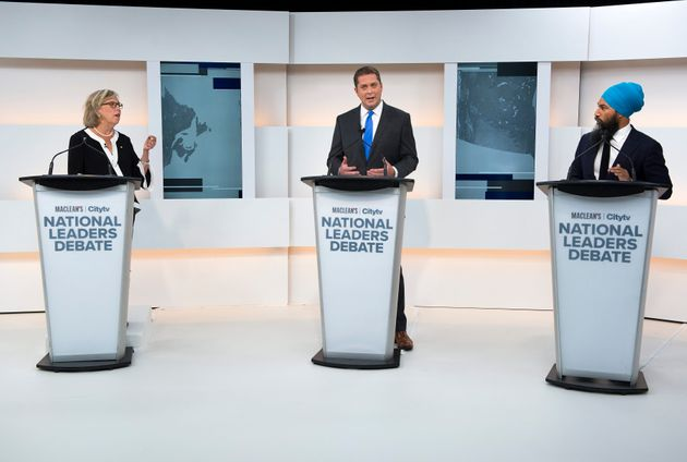 Green Party Leader Elizabeth May, left, Conservative Leader Andrew Scheer, centre, and NDP Leader Jagmeet...