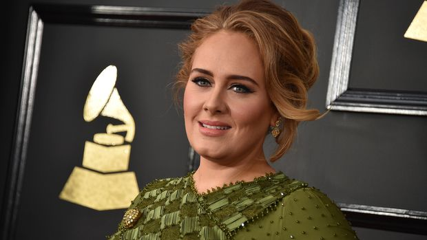 "FILE - In this Feb. 12, 2017, file photo, Adele arrives at the 59th annual Grammy Awards at the Staples Center in Los Angeles. Adele and her husband Simon Konecki have separated. The pop singer's representatives Benny Tarantini and Carl Fysh confirmed the news Friday, April 19, 2019 in a statement to The Associated Press. The statement read: ""Adele and her partner have separated. They are committed to raising their son together lovingly. As always they ask for privacy. There will be no further comment.""  (Photo by Jordan Strauss/Invision/AP, File)"