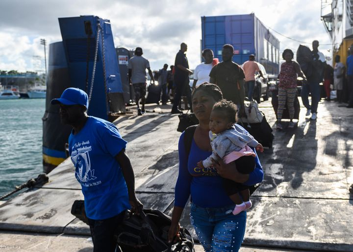 Evacuees get off a ferry after leaving Marsh Harbour on Abaco Island in the aftermath of hurricane Dorian on Sept. 9. Preside