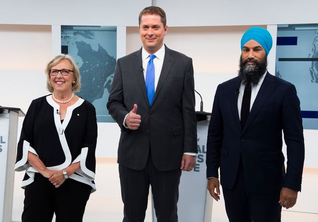 Green Party Leader Elizabeth May, Conservative Leader Andrew Scheer, and NDP Leader Jagmeet Singh pose...