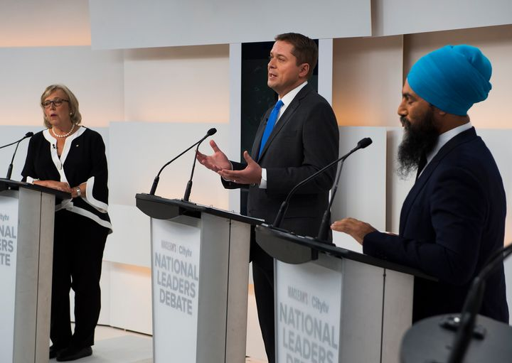 Conservative Leader Andrew Scheer, centre, speaks as Green Party Leader Elizabeth May and NDP Leader Jagmeet Singh listen during the Maclean's/Citytv National Leaders Debate in Toronto on Sept. 12, 2019.