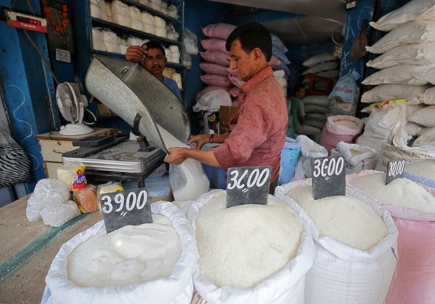 A man packs sugar for sale inside a shop at a marketplace in Ahmedabad, India, September 19,