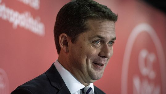 May Lampoons Scheer By Calling Him A Ventriloquist Puppet For