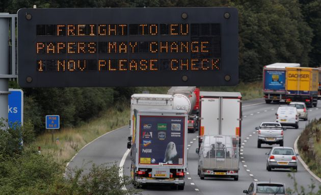 Vehicles pass beneath a sign warning of possible changes to freight procedures following Brexit on the...