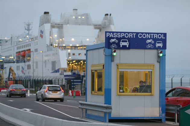 A French custom officer works in a booth at the transit zone at the port of Ouistreham, Normandy, Thursday,...