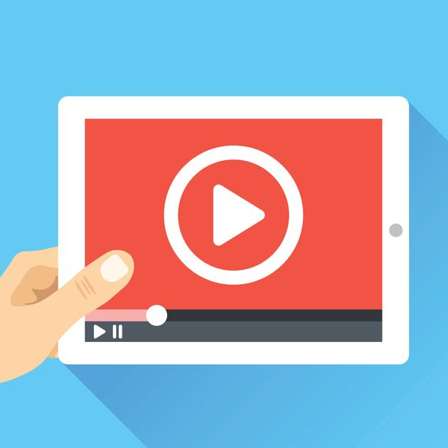 Hand holding tablet with video frame and play button. Video marketing, online cinema. Modern flat illustration,...