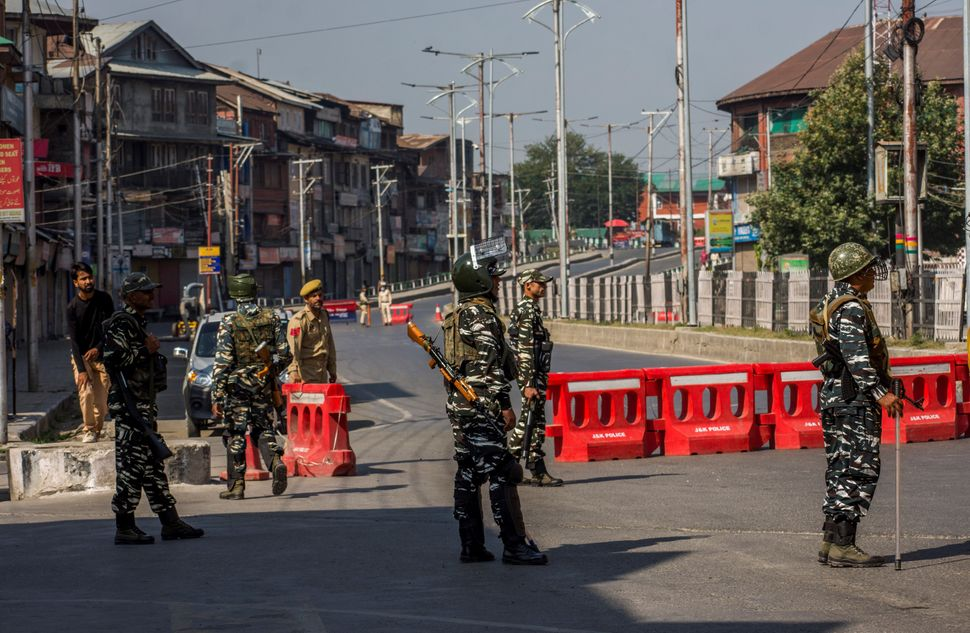 Government forces stand guard during curfew-like restrictions in the city center on September 08, 2019 in Srinagar, Kashmir.
