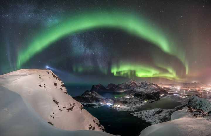 The Watcher by&nbsp;Nicolai Br&uuml;gger.<br /><br />The photographer hiked in the snow to the top of the mountain Offers&oslash;ykammen in Norway to witness and capture the breathtaking giant aurora over the Lofoten Islands. He waited many hours and after midnight, the bright Northern Lights finally appeared.&nbsp;