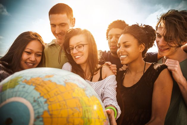 Group of friends holding an earth globe on the