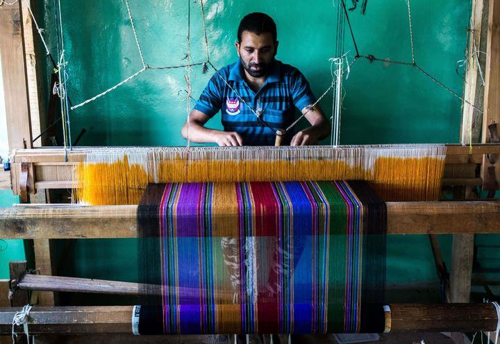 A Kashmiri artisan weaves pashmina shawl in outskirts of Srinagar on Sept. 17, 2015.