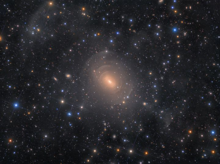 Shells of Elliptical Galaxy NGC 3923 in Hydra, Rolf Wahl Olsen.<br /><br />This is a deep image of the peculiar, elliptical galaxy NGC 3923. The galaxy features myriad concentric shells as a result of past mergers with other nearby galaxies. A prominent stream of stars extends towards the lower right, terminating abruptly in a shell-like fragment.